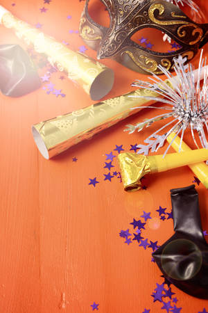 Happy New Year Party Decorations on dark wood table  with applied filters and lens flare. Stock Photo