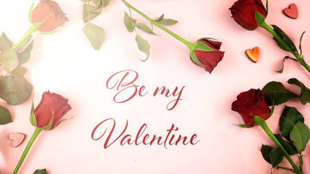 Happy Valentines Day overhead flat lay wrapping gift and writing cards with Be My Valentine greeting text and lens flare.