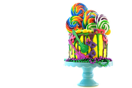 Mardi Gras theme on-trend candy land fantasy drip cake on white