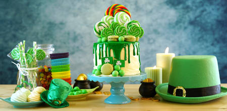 St Patricks Day theme candyland novelty drip cake and party table.