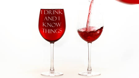Red wine glasses with I drink and I know things text on white