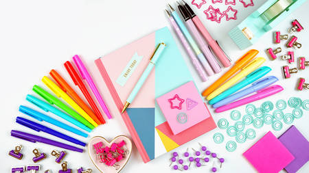 Back to school or workspace colorful stationery overhead flat lay.