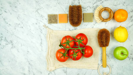 Zero-waste, plastic-free household flatlay overhead with coconut fiber, bamboo and reusable kitchen and food preparation products.
