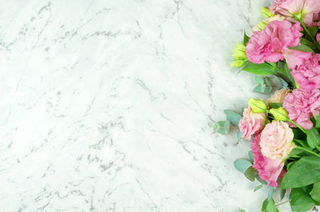 White marble texture  copy space with pink flowers border frame.