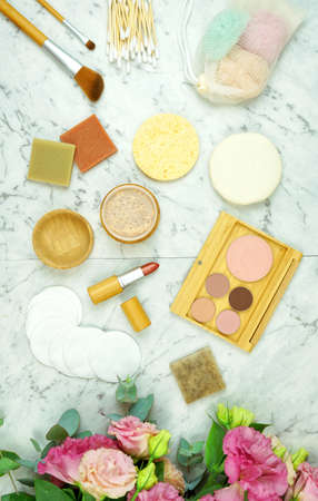 Zero-waste, plastic-free beauty and makeup flat lay overhead with coconut fiber, bamboo and reusable products. Reklamní fotografie