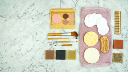 Zero-waste, plastic-free beauty and makeup flatlay overhead with coconut fiber, bamboo and reusable products. Reklamní fotografie