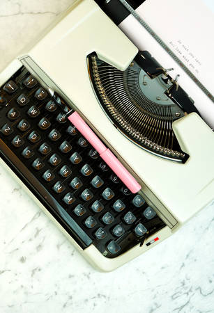 Old vintage typewriter on white marble table with copy space. Фото со стока