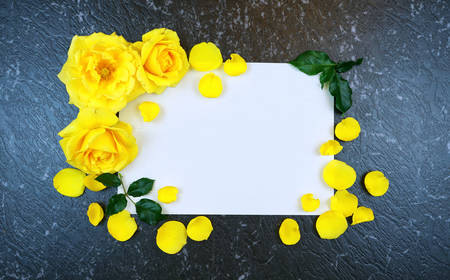 Yellow roses border for greeting card inspirational message on black marble