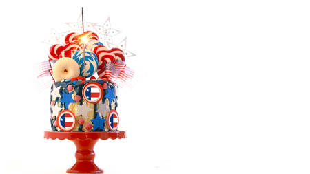 USA theme on-trend candy fantasy drip cake with lollipops and handmade candy decorations on white Stock Photo