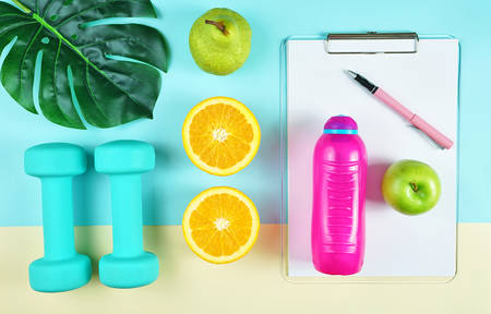 Health and fitness concept flatlay with exercise equipment on modern colorful background. 写真素材