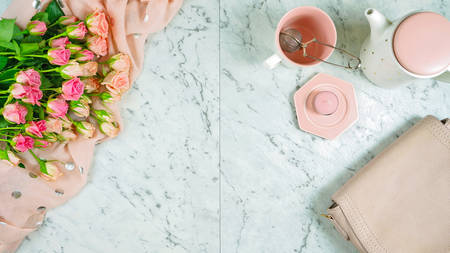 Welcoming Spring theme concept flat lay tea break with pink roses and female accessories with copy space. 写真素材