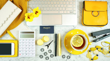 Planning budgeting and booking travel and vacation concept with touchscreen laptop, smart phone and modern yellow accessories. 写真素材