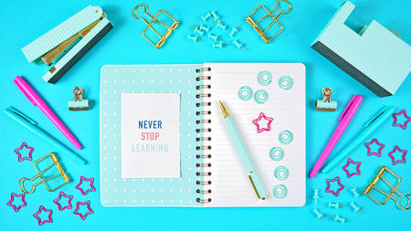 Back to school concept with blue theme notebook with stationery flatlay overhead..