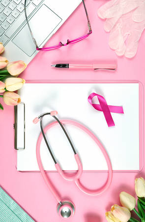Pink Ribbon Breast Cancer Awareness concept with female pink doctors desk concept. Stock Photo