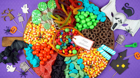 Colorful Happy Halloween trick or treat candy grazing platter charcuterie board.