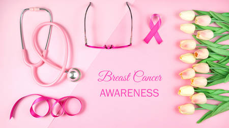 Pink Ribbon Breast Cancer Awareness Month concept flat lay on pink Imagens
