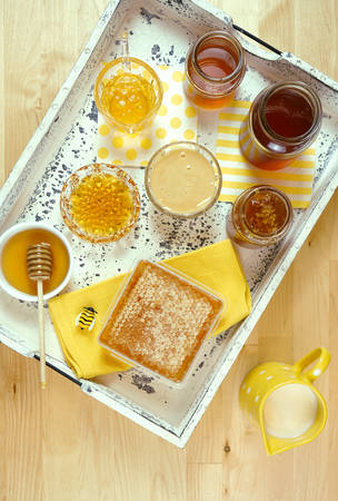 Variety of different types of honey including honeycomb