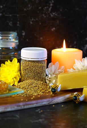 Honey related products with closeup of bee pollen, which is harvested as food for humans, with various health claims for improved stamina and energy.
