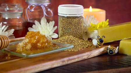 Honey and related products including honeycomb, pollen and beeswax for many household uses including candle making close up.
