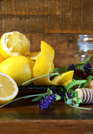 Traditional honey served with lemons on rustic wood