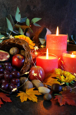 Thanksgiving cornucopia table setting centerpiece close up. Stock Photo