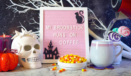 Funny Halloween My Broomstick Runs on Coffee letter board. Banque d'images