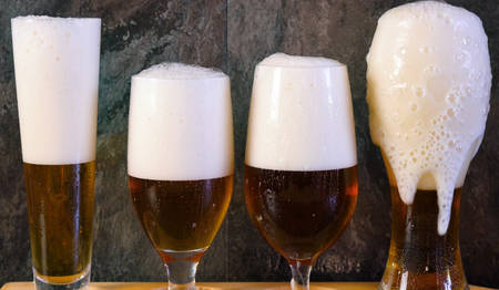 Pouring beer into traditional beer glasses, beer tasting.