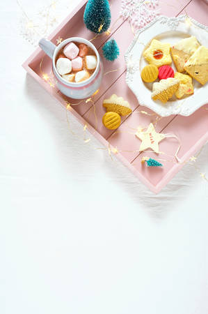 Cozy Christmas indoors tray of goodies with with copy space. Stock Photo