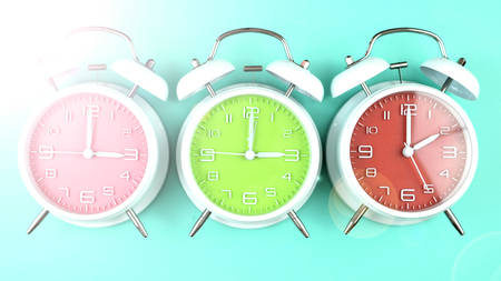 Springtime Daylight Saving Time Clocks on bright springtime background.