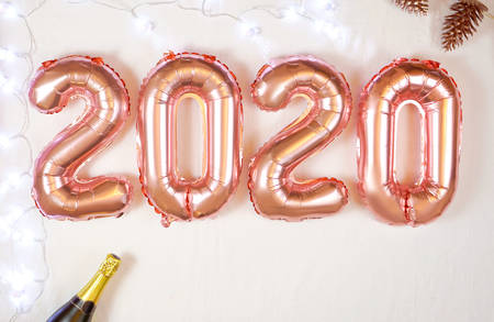 Happy New Year 2020 rose gold metallic balloons on white background. Stock Photo