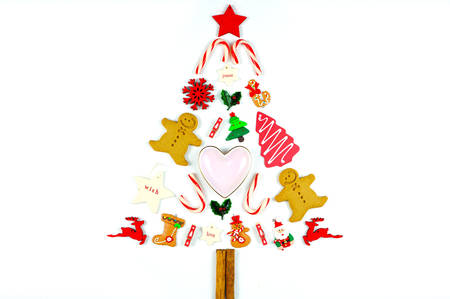Minimalism Christmas tree and decorations on a white background.