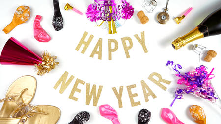Happy New Years Eve banner with champagne and pink and gold party decorations. Stock Photo
