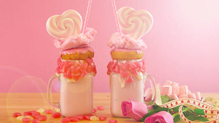 Valentines Day freak shakes with heart shaped lollipops and donuts.