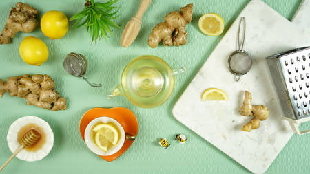 Ginger tea served with lemon and honey.