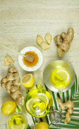 Ginger and lemon herbal tea preparation flat lay, with its high levels of Vitamin C, magnesium and other minerals, ginger root is extremely beneficial for health and the immune system. Copy space.