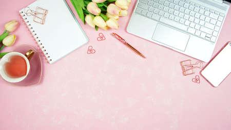 Feminine pink desktop workspace blog header overhead flat lay.