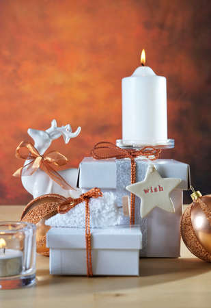 Christmas Copper and White Gifts stacked on a festive table setting.