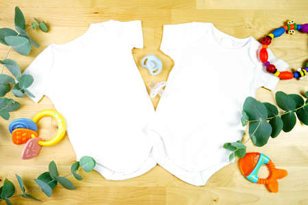 Light natural theme baby apparel top view flat lay. Mock up