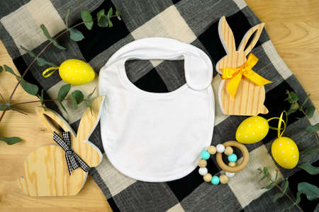 Easter farmhouse theme baby apparel top view flatlay. Mock up.