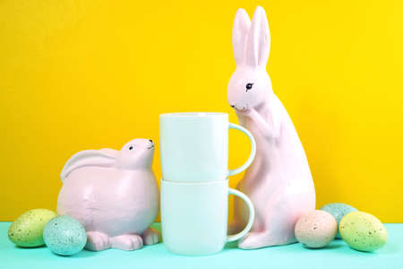 Easter product mockup with pink bunnies, easter eggs against yellow background.