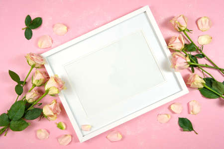 Mother's Day Valentine wedding birthday feminine theme white border picture frame styled with blush pink roses against a pink textured background. Mockup. Copy space.
