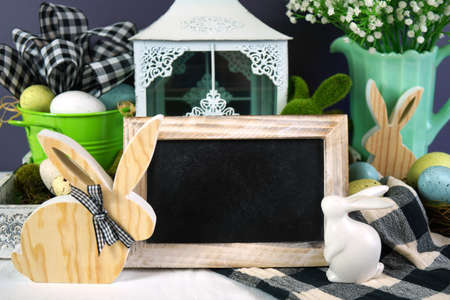 Easter farmhouse vignette with bunnies, Easter eggs and buffalo plaid check.