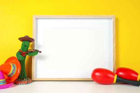 Cinco de Mayo horizontal frame mockup against a festive yellow background