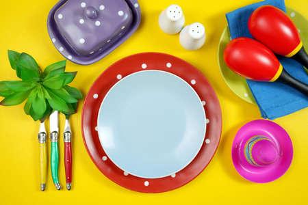 Cinco de Mayo table setting flatlay on colorful yellow table