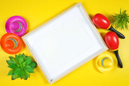 Cinco de Mayo frame flatlay on bright yellow table background