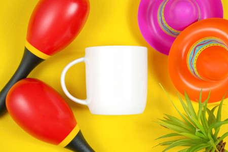 Cinco de Mayo coffee mug flatlay on colorful yellow table background