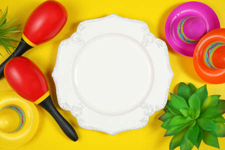 Cinco de Mayo plate table setting flatlay on colorful yellow table background