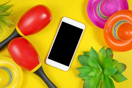 Cinco de Mayo smart phone flatlay on a festive yellow table background,