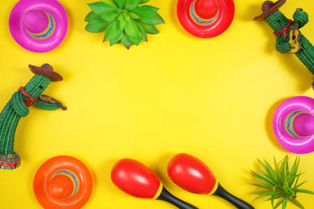 Cinco de Mayo background flatlay on a festive yellow table background,