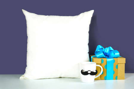 Fathers Day or masculine birthday theme throw pillow styled with gifts.